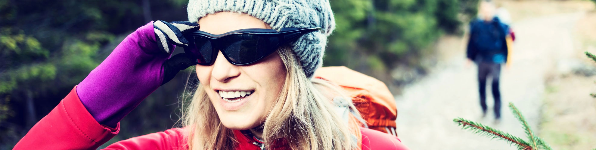 woman hiking wearing sunglasses